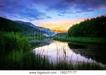 Sunset over the Ribnica river in Slovenia