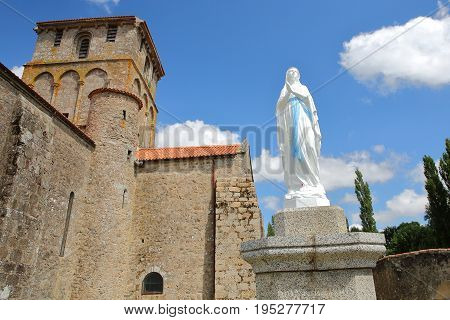 Vieux Pouzauges Church with a statue of Virgin Mary in the foreground, Pouzauges, Vendee, France