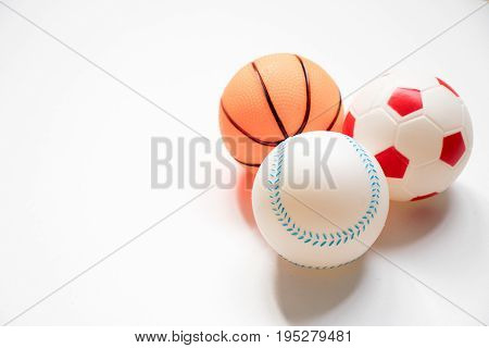Group of football baseball and basketball placed on white background