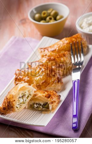 little strudel filled with ricotta and olives, selective focus