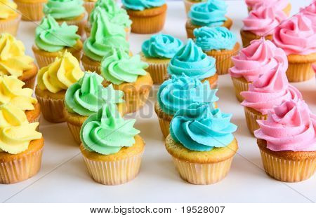 lots of fancy rainbow cupcakes