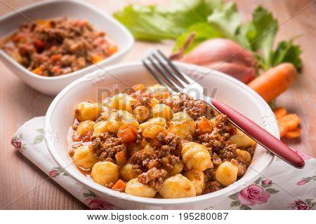 homemade gnocchi with ragout sauce, selective focus