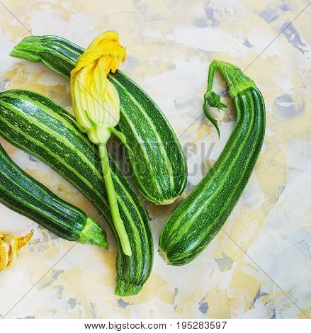 Fresh zucchini on Light background with a flower
