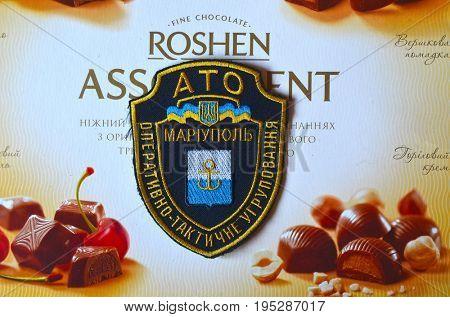 ILLUSTRATIVE EDITORIAL.Chevron of Ukrainian Army. With logo Roshen Inc. Trademark Roshen is property of Ukrainian president Poroshenko. Kiev,Ukraine.July 11, 2017