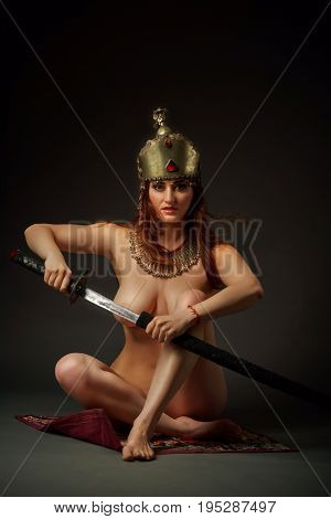 Female in antique bousani jewellery and wedding helmet with sword
