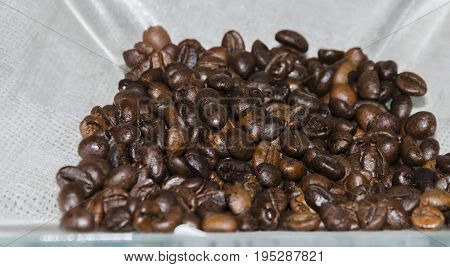 Brown flavored coffee medium roast in bulk for the preparation of an invigorating drink close-up