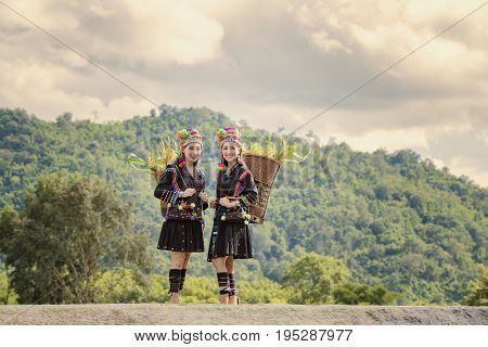tribe in beautiful costume dressbeautiful Tribal girltribes on the mountain in sunsettribe in beautiful costume dresstribe in traditional uniform Traditional tribal culture.