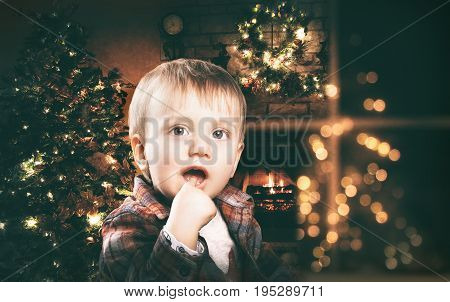 Adorable happy little boy at colored background
