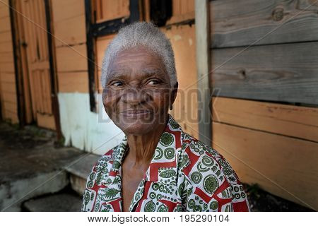 JAN 20 2017 - Santo Domingo Dominican Republic Portrait of unknown african old woman sitting in front of her house
