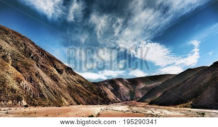 Trail Around The Mountain Of Seven Colours Cerro de los Siete Colores located in the Quebrada de Humahuaca which is a UNESCO World Heritage Site since 2003. Jujuy Argentina