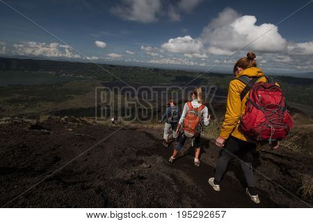 Team of hikers walking in the valley