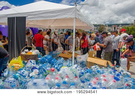 Quito, Ecuador - April, 17, 2016: Unidentified citizens of Quito providing disaster relief water for earthquake survivors in the coast.