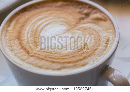 A cup of cappuccino. Caffeine Macro. Shallow DOF