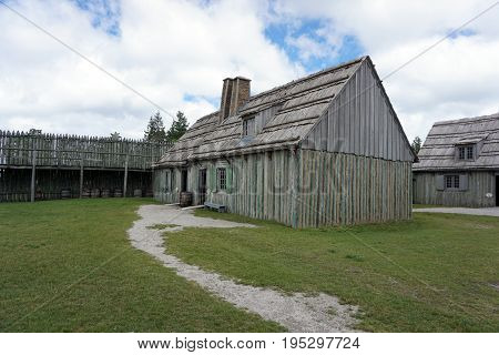A wooden rowhouse in Fort Michilimackinac, in the Colonial Michilimackinac State Park, in Mackinaw City, Michigan, during June.
