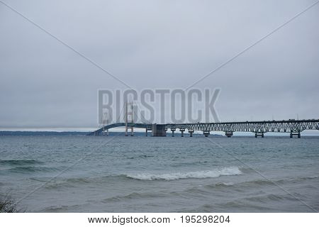 The Mackinac Bridge spans the Straits of Mackinac, between Lakes Michigan and Huron, to connect Michigan's Lower and Upper Peninsulas, from Mackinaw City to St. Ignace.