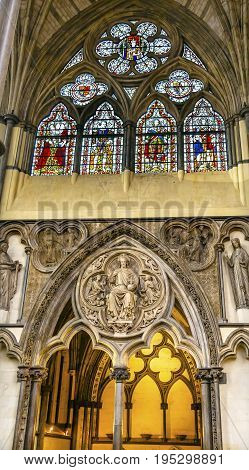 LONDON, ENGLAND - JANUARY 16, 2017 Interior Arches Stained Glass Jesus Statue 13th Century Chapter House Westminster Abbey Church London England. Westminister Abbey has been the burial place of Britain's monarchs since the 11th century and is the setting