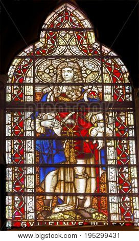 LONDON, ENGLAND - JANUARY 16, 2017 King George III Stained Glass 13th Century Chapter House Westminster Abbey Church London England. King George III was King during the American Revolution. Westminister Abbey has been the burial place of Britain's monarch