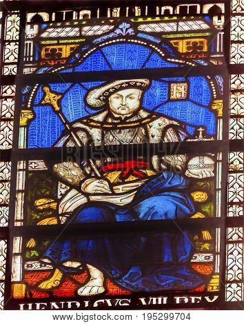 LONDON, ENGLAND - JANUARY 16, 2017 King Henry VIII Stained Glass 13th Century Chapter House Westminster Abbey Church London England. Westminister Abbey has been the burial place of Britain's monarchs since the 11th century and is the setting for many coro