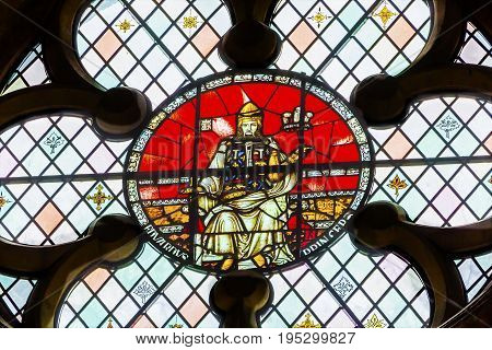 LONDON, ENGLAND - JANUARY 16, 2017 King Edward 1 of Elder Stained Glass 13th Century Chapter House Westminster Abbey Church London England. King Edward 1 from 899 until 924 son of Alfred the Great. Westminister Abbey has been the burial place of Britain's
