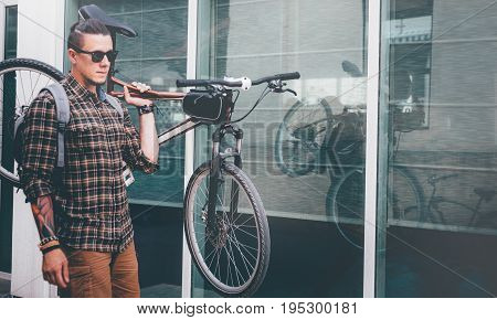 Handsome Young Man Ciyclist With Glasses Carries Bicycle On His Shoulder Street Daily Routine Lifestyle