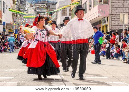 Banos De Agua Santa Ecuador - 29 November 2014: Multi-Ethnic Couples Dancing On The Streets Of Ecuador Banos De Agua Santa South America On November 29 2014