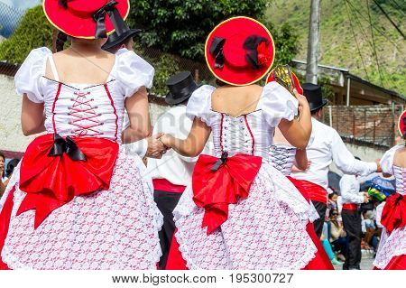 Group Of Hispanic People From Ecuador Is Dancing On The Streets Of Banos De Agua Santa South America Christmas Holiday