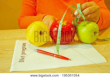 The concept diet food weight loss. Female measuring tape and Apple. Time for diet slimming - Retro color