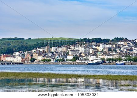 Bideford North Devon England 13th July 2017 - The town and old bridge in the port of Bideford in North Devon England looking west across the river Torridge. The MV Oldenburg is sailing to Lundy Island taken from the Tarka Trail.