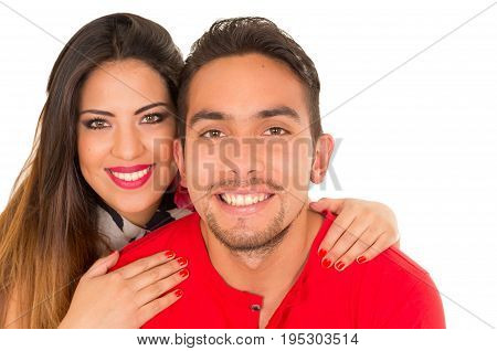Close up of happy couple isolated on white background. Attractive man and woman being playful.