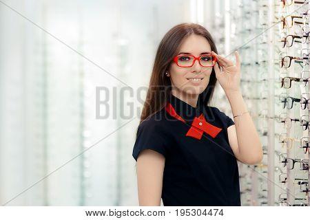 Fashion Woman Wearing Eyeglasses in Medical Optical Shop