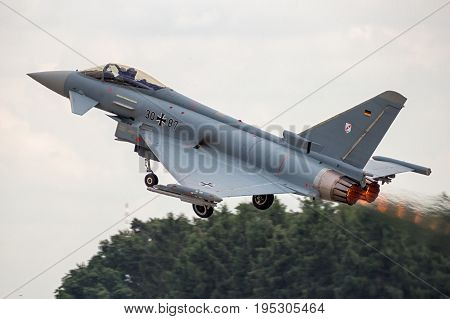 BERLIN - JUN 2 2016: German Air Force Eurofighter Typhoon afterburner take off from Berlin-Schoneveld airport.