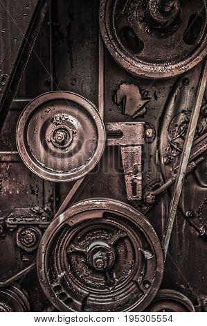 Car Engine. Driving beltbelt drivethe belt on the pulleys