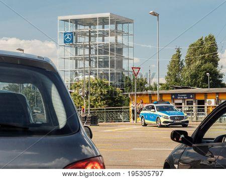 KEHL GERMANY - JUL 14 2017: German Police in Mercedes wagon car surveying the traffic on busy German street