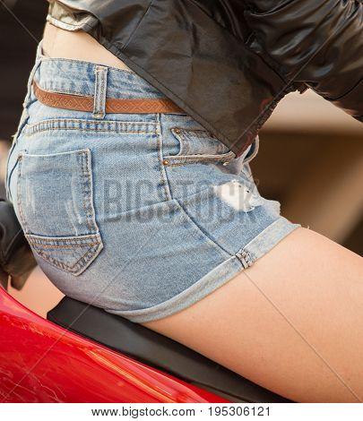 Beautiful short denim shorts on the girl .