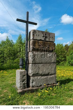Lahdenpohja, Republic of Karelia, Russia - June 12, 2017: Monument to the Finnish soldiers who died in Lahdenpohja in 1918. The monument is located opposite the ruins of the church of St. Yakkim.