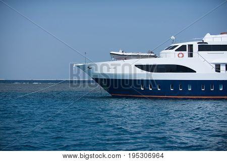 Ship liner beautiful large white marine transport sailing on blue sea water on natural background of sky summer vacation voyage adventure and tourism concept