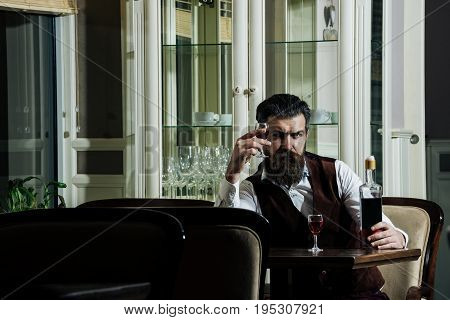 Customer Waiting With Bottle At Table Served For Two