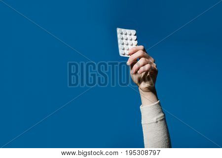 Treatment and hypnotic tablet. Health and medicine. hand with pills in blister pack. hand hold dieting pill and vitamin. Drug and antidepressant. copy space
