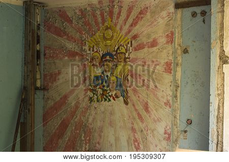 PRIPYAT, UKRAINE - JUNE 25: Common Soviet propaganda wall paint in abandoned room in ghost city of Pripyat in Chernobyl Exclusion Zone