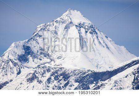 View of mount Dhaulagiri near Thorung La pass with beautiful sky round Annapurna circuit trekking trail Nepal