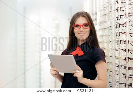 Woman with PC Tablet in Medical Optic Shop
