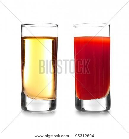 Delicious cocktail with tequila in shot glasses on white background