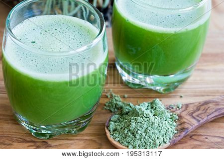 Barley Grass Powder On A Spoon, With Two Barley Grass Shots