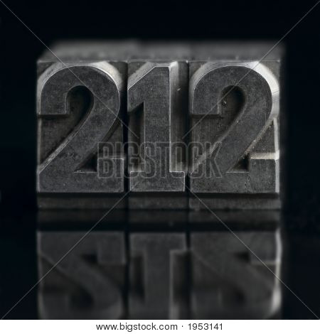 lead letters numbers (212 Manhattan area code) on black with reflection poster