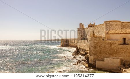 Detail of the wall on the sea of medieval Maniace's Castle in Siracusa