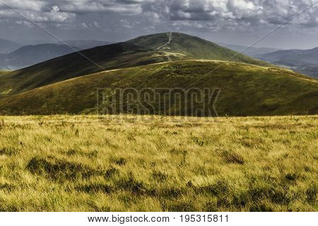 Summer view of Carpathian Mountains and Valleys, under blue sky with clouds