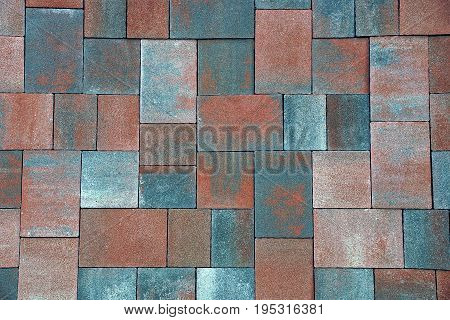 Brown background of stone tiles on the sidewalk