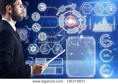 Side view of young businessman with document in hand standig in night office with digital business hologram. Technology and analytics concept. 3D Rendering