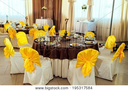 Table served for wedding banquet. Table setting. Number of guest table at wedding banquet