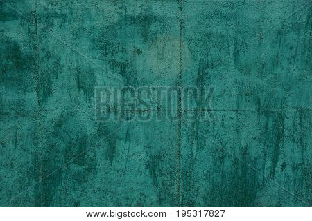 Texture of a grated old green iron wall of a private building
